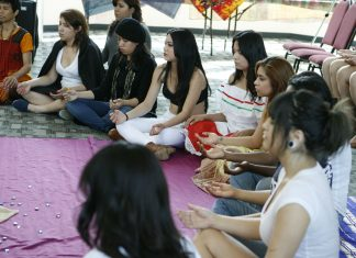 woman sit in circle meditating