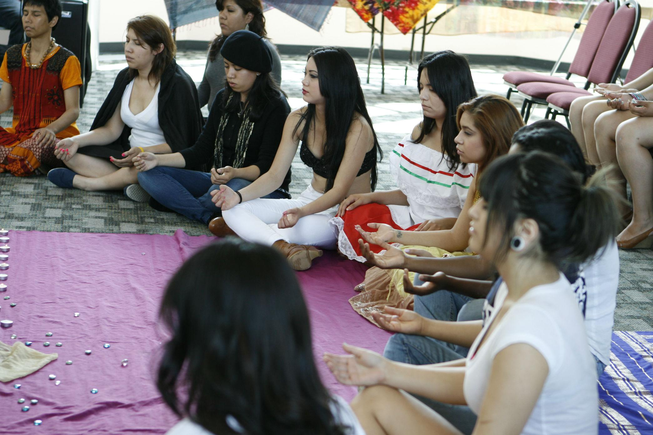 Students take part in the meditation exercise lead by Amelia Soto, a Kundalini Yoga teacher. (Loren Townsley / The Sundial)