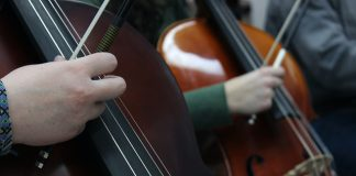 hands playing cello