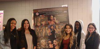 4 woman pose around poster