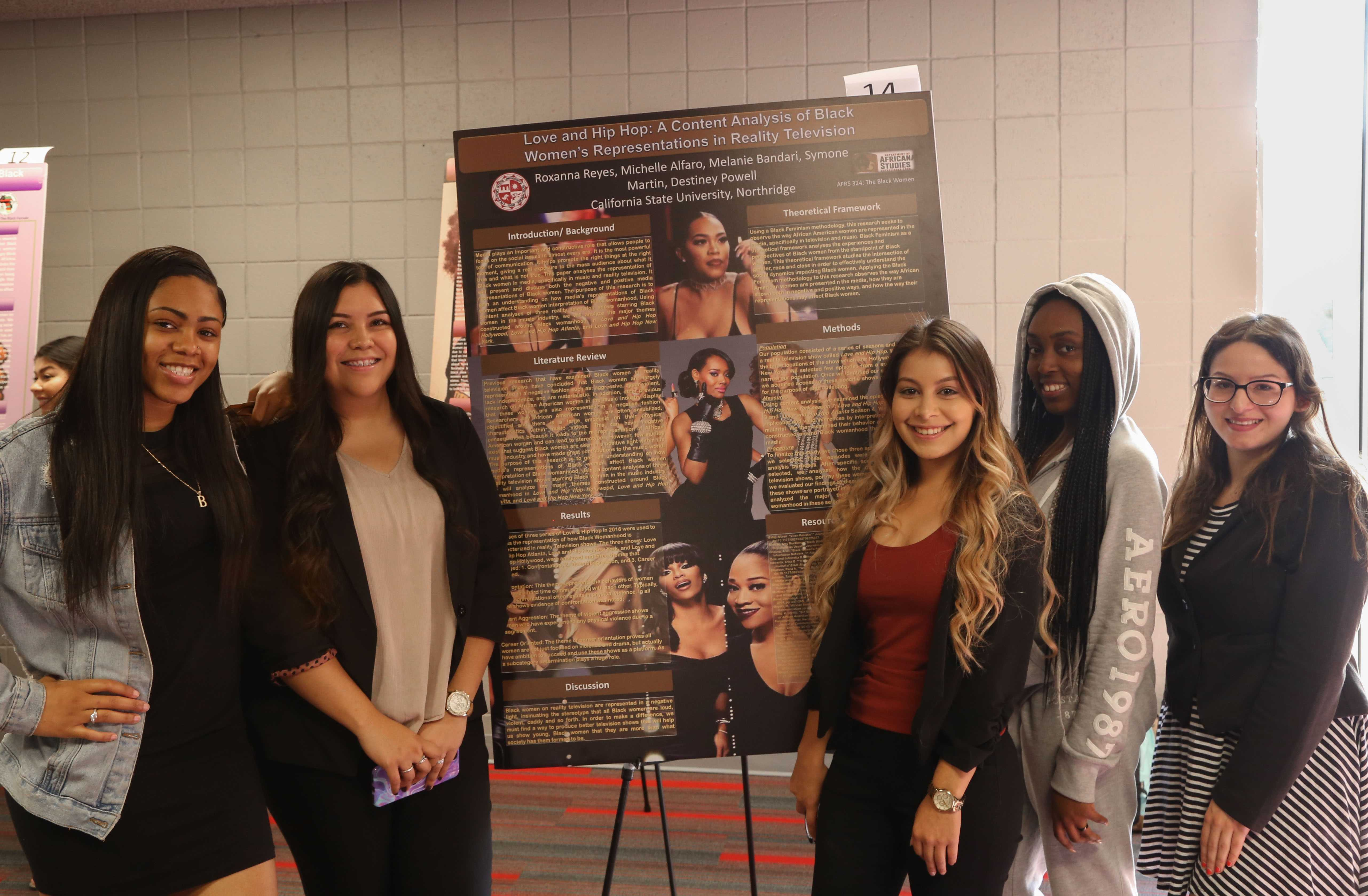 CSUN students (left to right) Destiney Powell, Michelle Alfaro, Roxanna Reyes, Simone Martin, and Melanie Bandari, share their poster, Love and Hip Hop: A Content Analysis of Black Women's Representation in Reality Television, for the Bi-annual Men/Women of Color Enquiry in Northridge, California, Friday, November 17, 2017. Photo credit: John Hernandez
