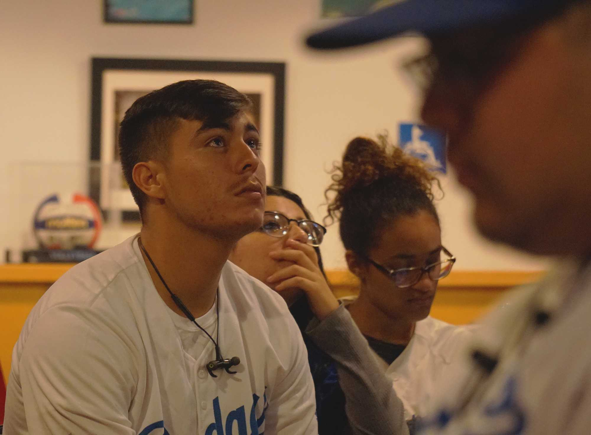 Dodgers Fans and CSUN Students, Daniel Reyes (left) and Beverly Figueroa (middle left) watch the Astros take to the field after beating out the Dodgers in the World Series 2017. Photo credit: Aaron Lanuza
