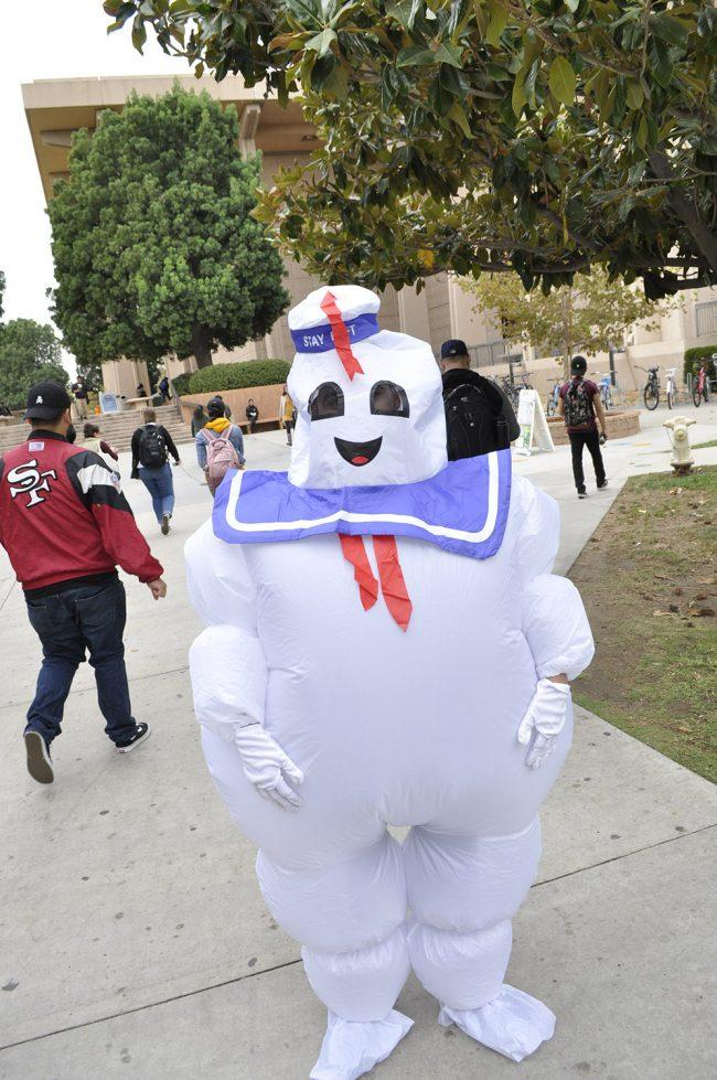 student dressed up in white and purple inflatable costume