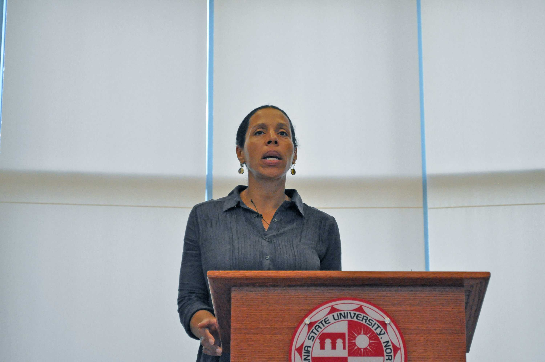 woman in denim blouse at podium
