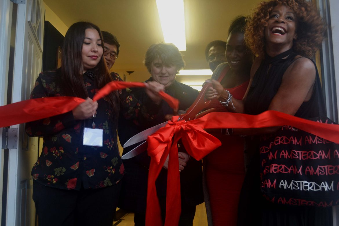 red+ribbon+being+cut+by+large+red+scissors