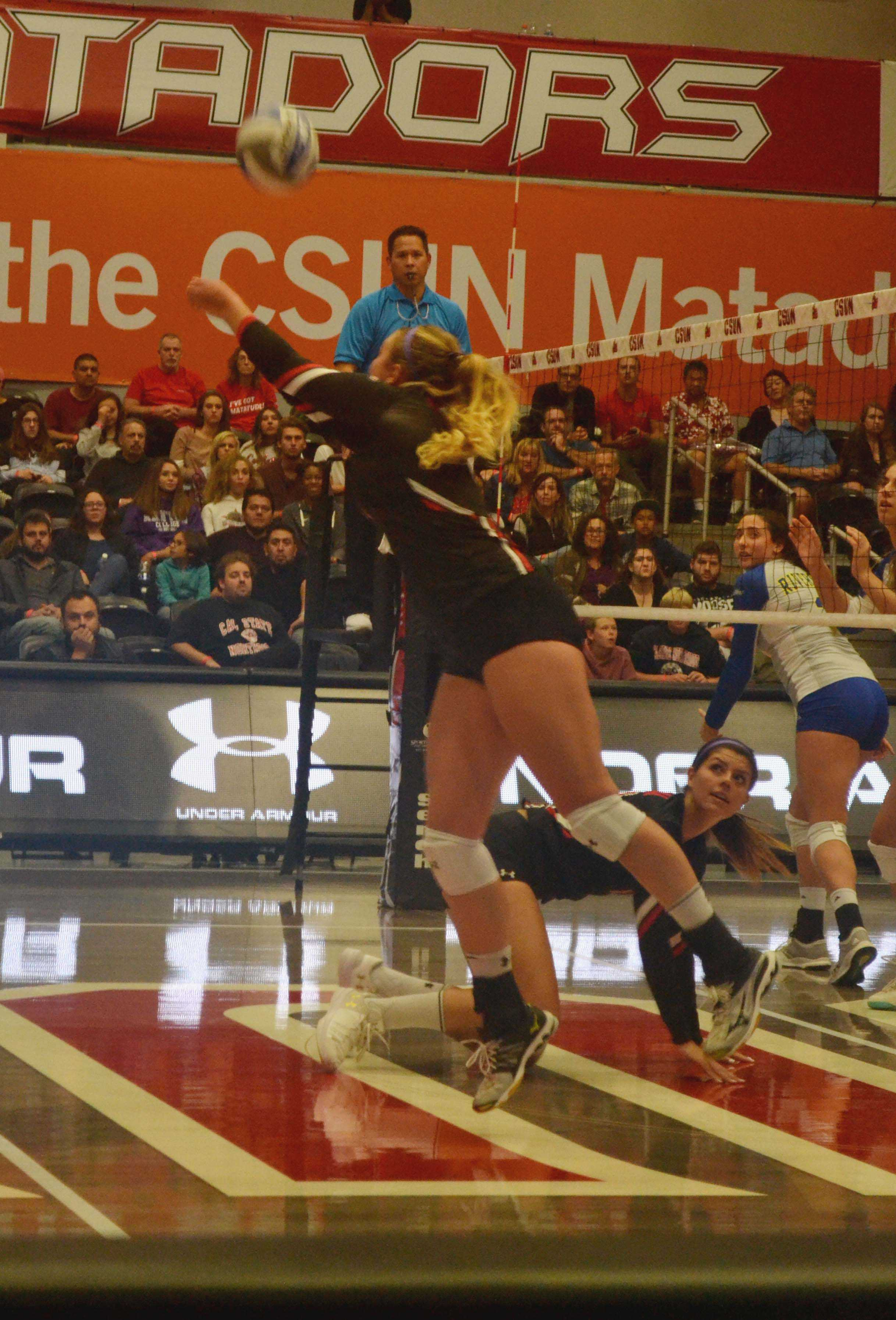 CSUN woman volleyball player in action hitting a ball