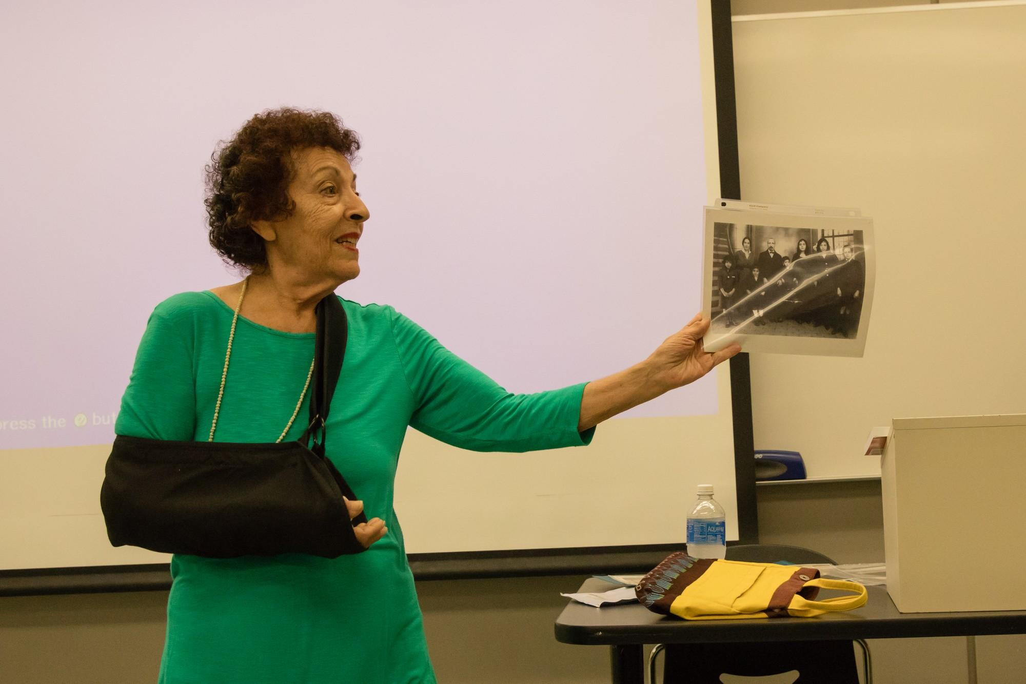 Esther Shifren passes a photo of her Jewish family who lived in China for a century around the classroom. Photo credit: Max Sullivan