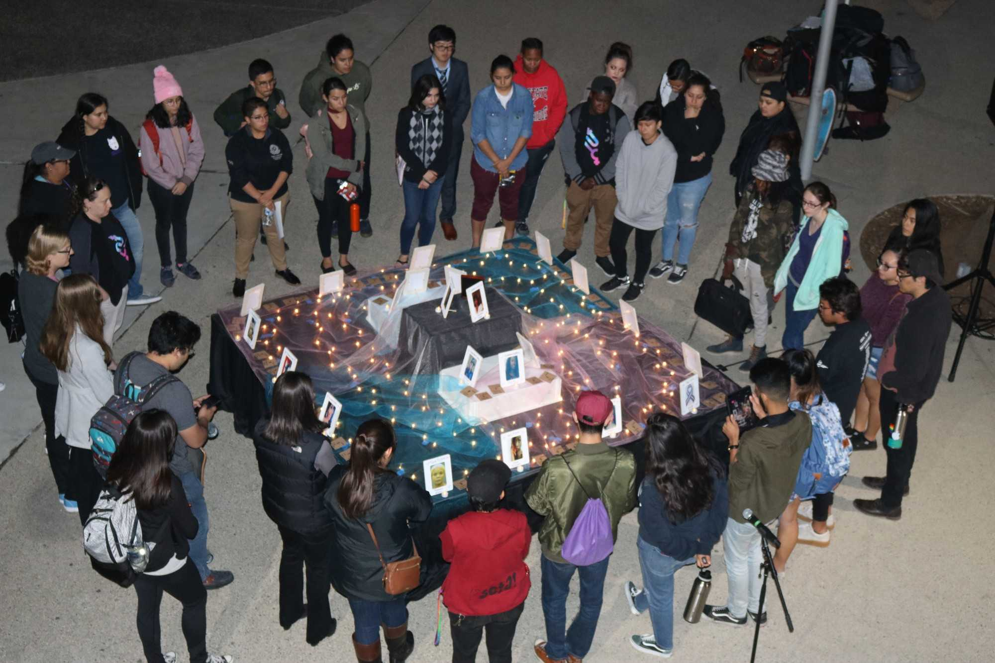 students stand around square alter
