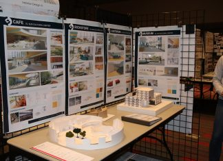 display in white and light brown colors on table surrounded by interior designs of buildings