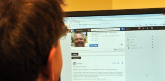 man scrolling through social media