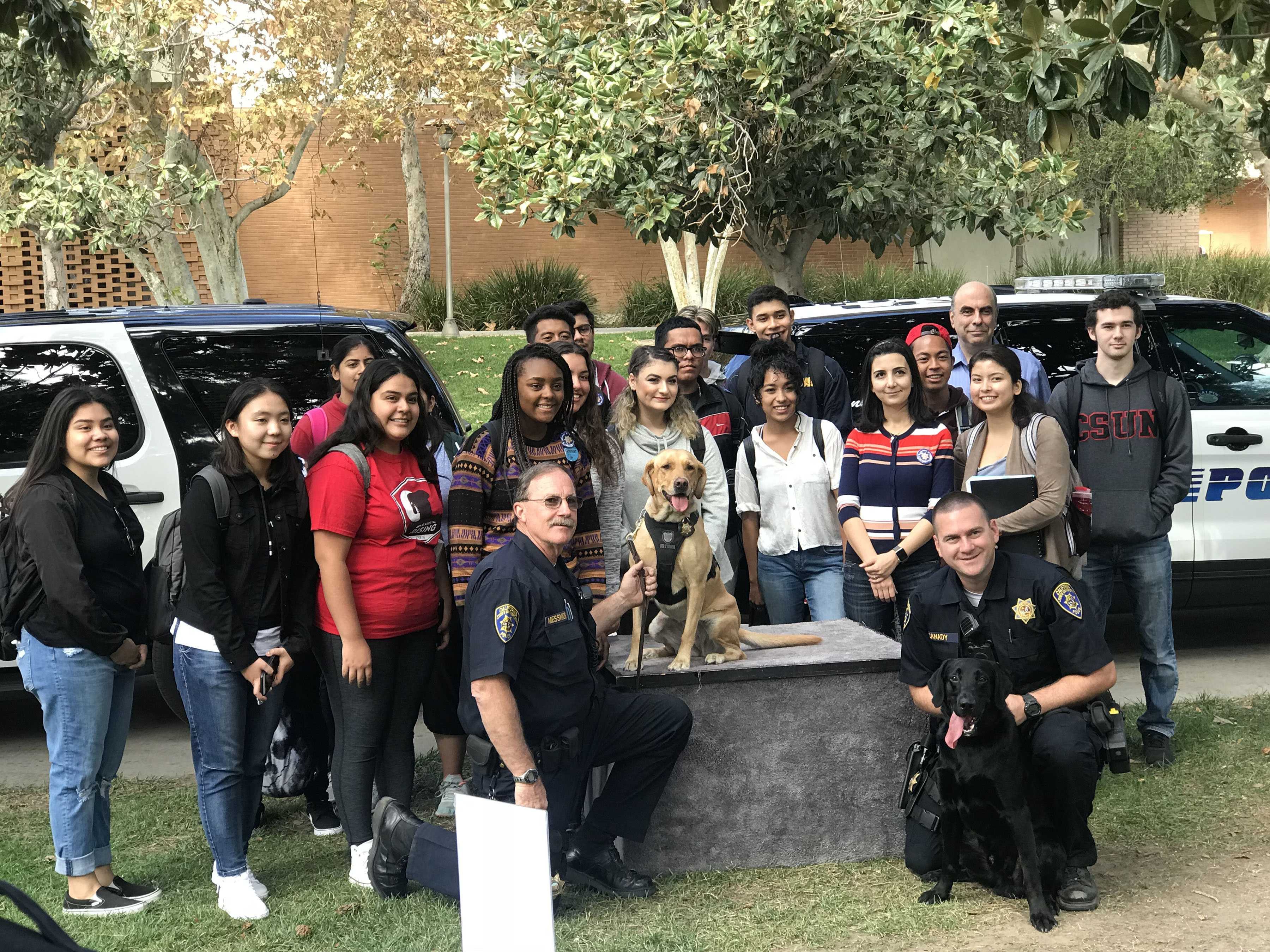 CSUN PD officers and students pose with Daisy and Tank.