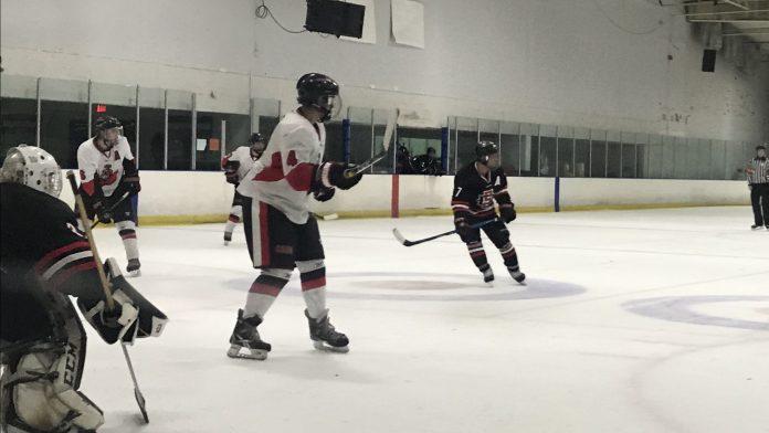 CSUN hockey team in white preparing to score