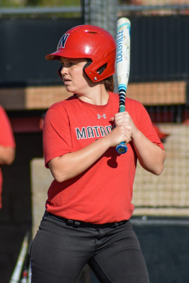 softball player at bat in red uniform