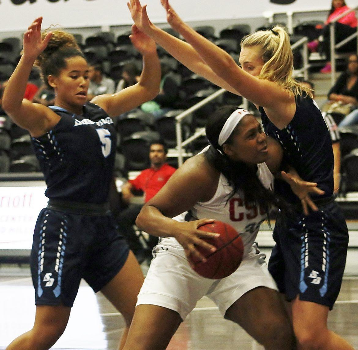 CSUN womans basketball player defending ball during game
