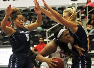 CSUN womans basketball player defending ball during game