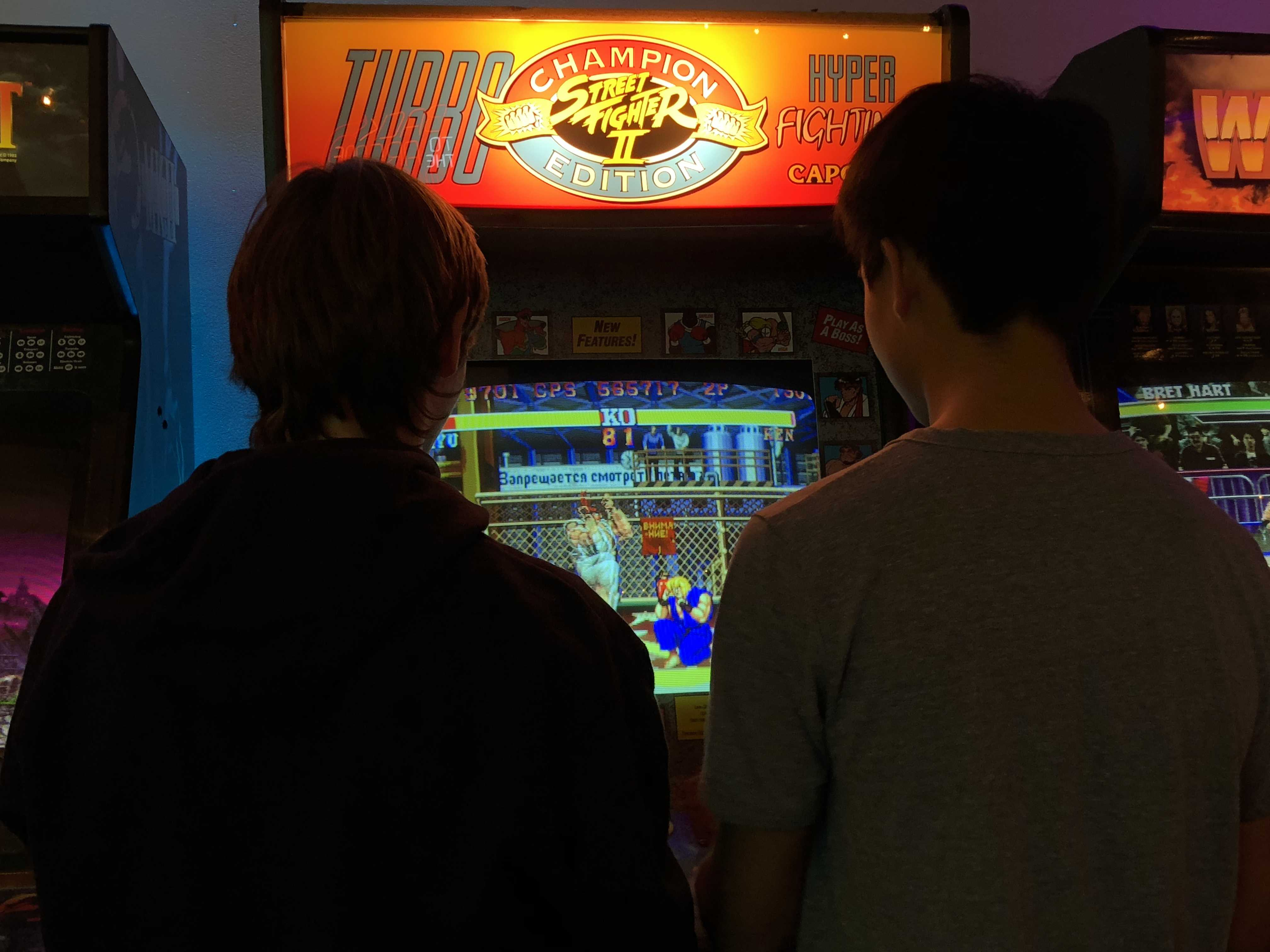 Two students engaged in a fighting match in Street Fighter II Turbo. Photo credit: Jacob Pascua