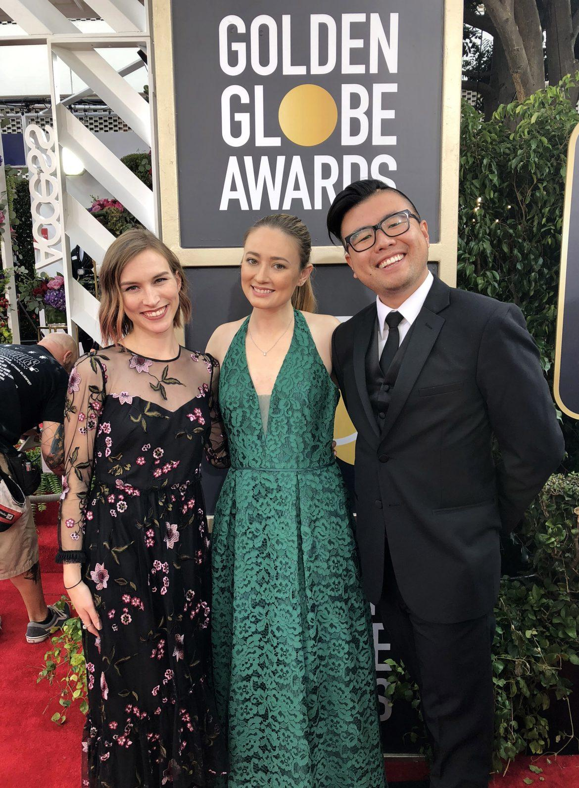 Allison Bird (left), Amanda Derzy (center) and Robert Ahn (right) in the middle of the red carpet at the Beverly Hilton Hotel.