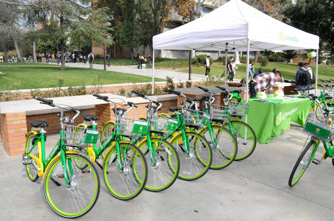 green+Lime+Bikes+parked+outside+next+to+Lime+Bike+booth
