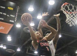 CSUN player goes to dunk basket ball