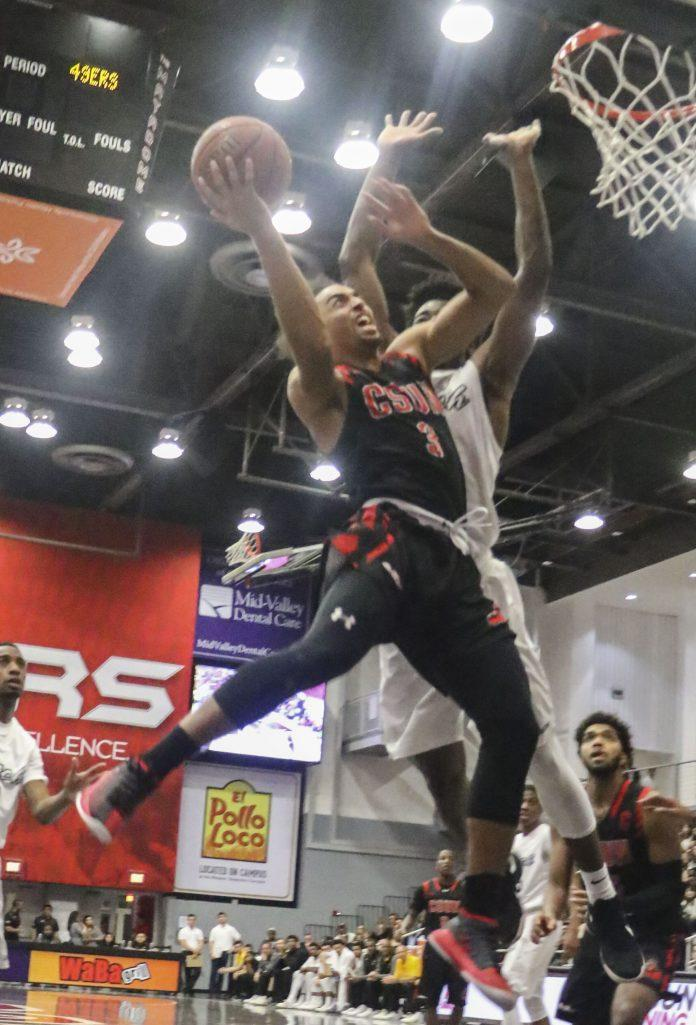CSUN player goes to dunk basket ball