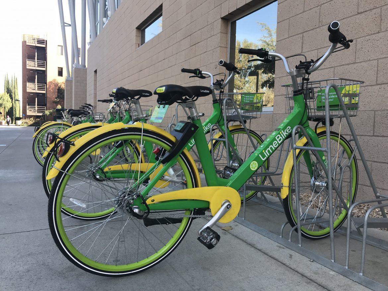 green and yellow Lime Bike in bike rack