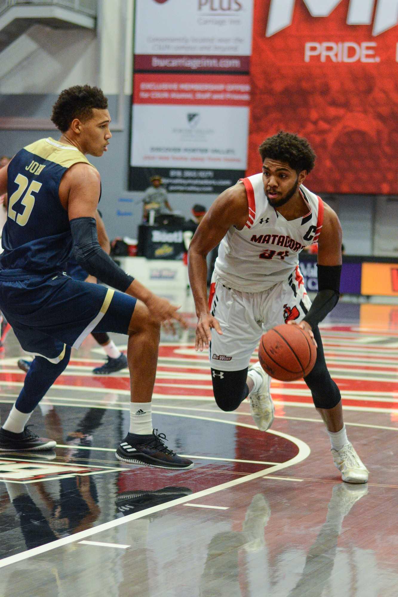 CSUN mens basketball player defending the ball