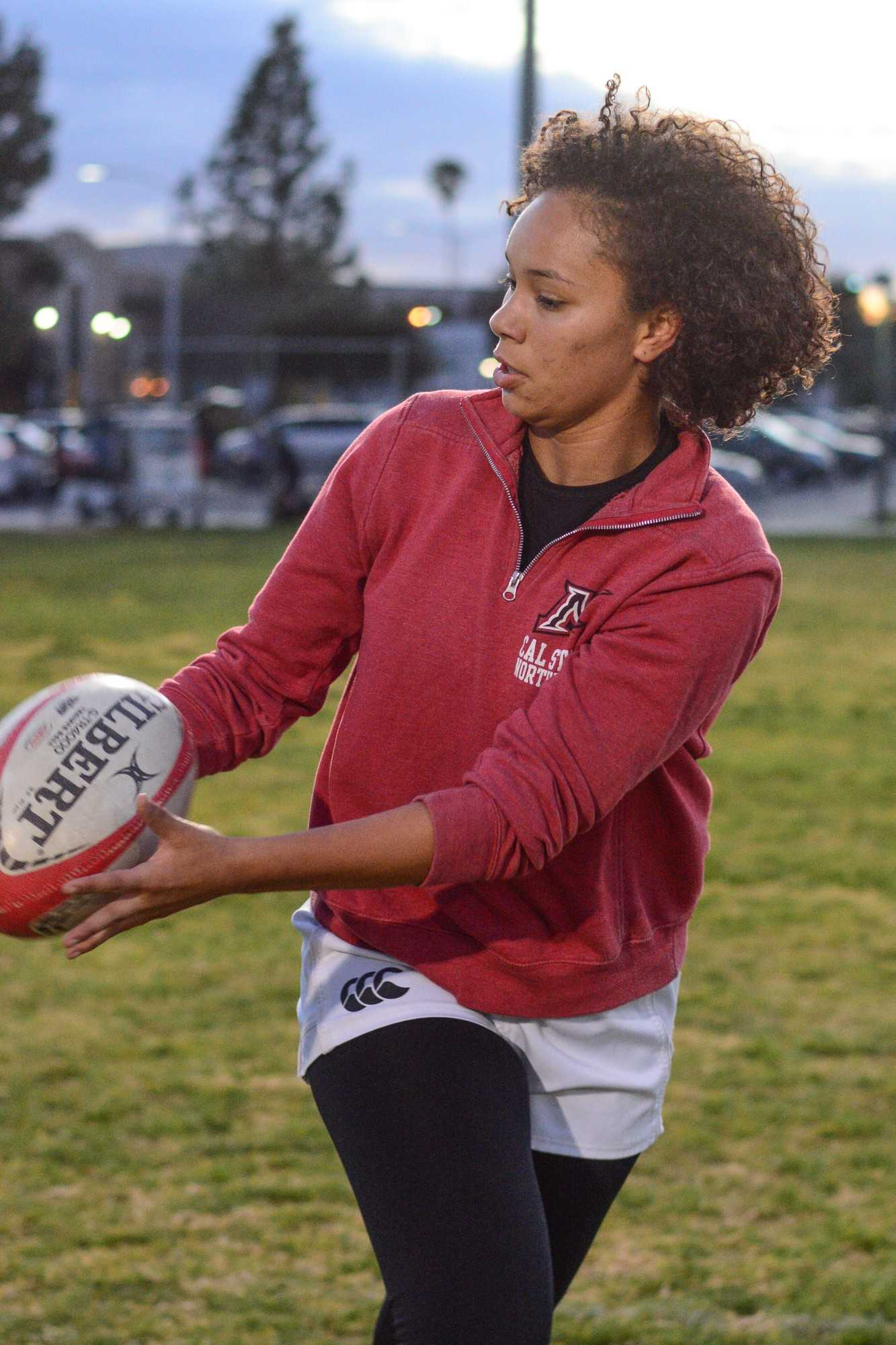 womans rugby player in action