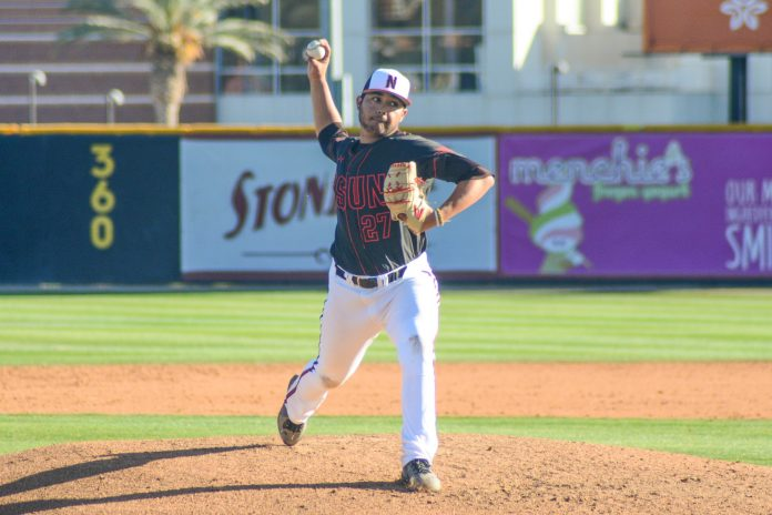 CSUN baseball player throws a pitch