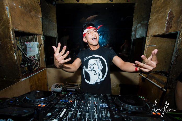 man excitedly DJ's