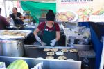 woman busily making pupusas