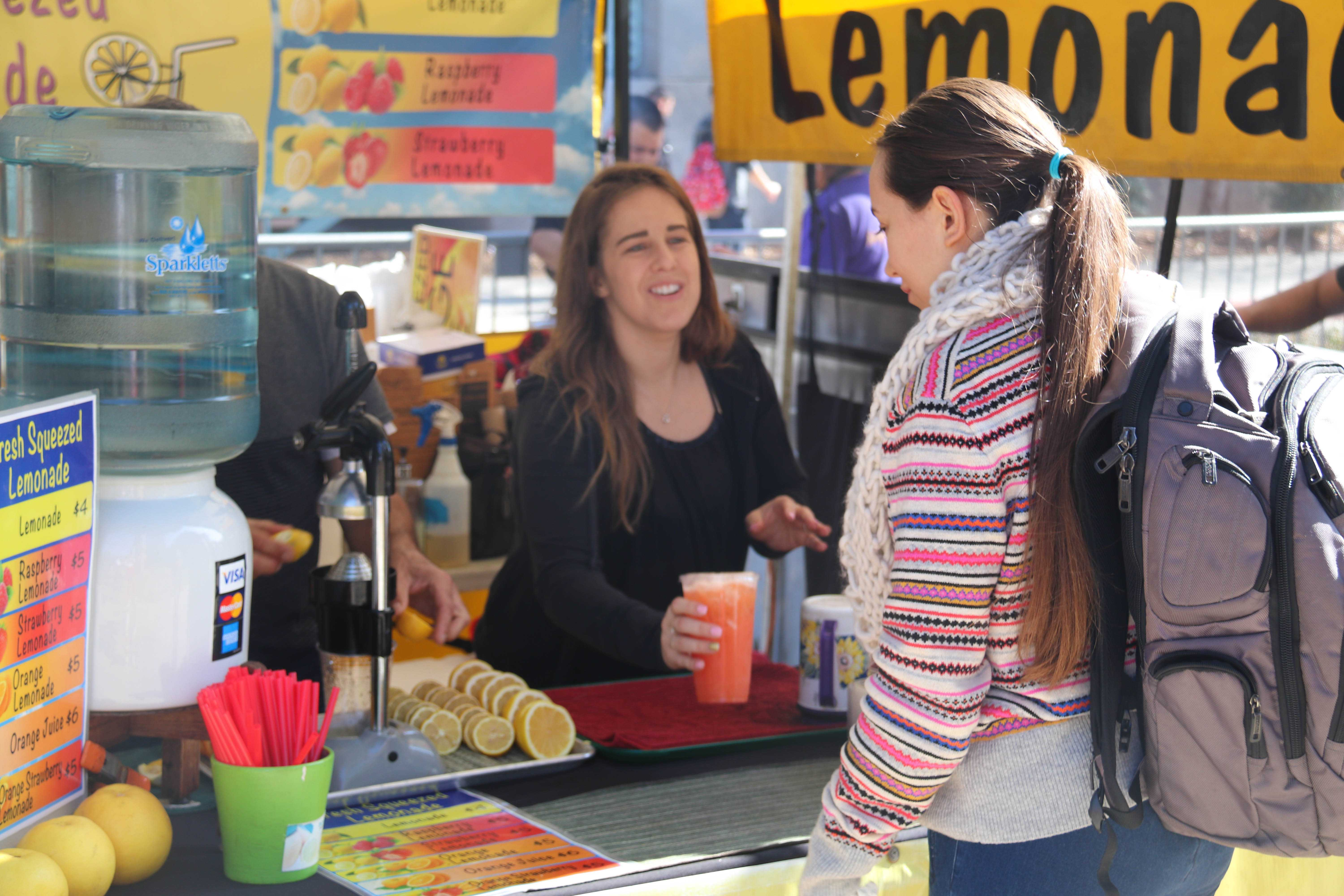 student buying lemonade from a lemonade stand