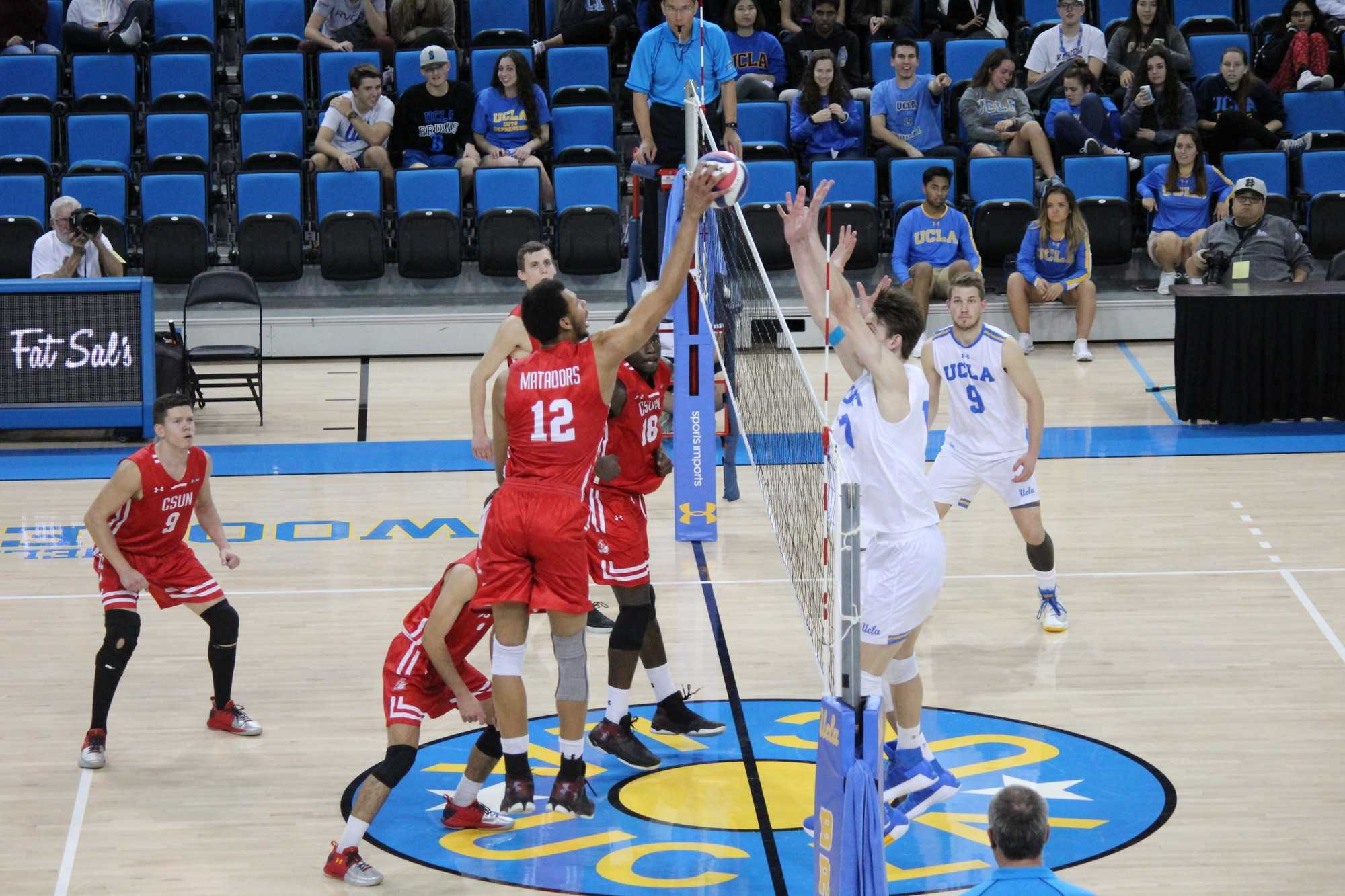 CSUN's Arvis Greene (#12) with the tip into the Bruins wall. Greene had 16 kills but the Matadors fell to UCLA in four sets. Photo credit: Justin Vigil