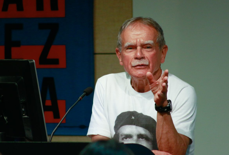 man seriously speaking at a podium