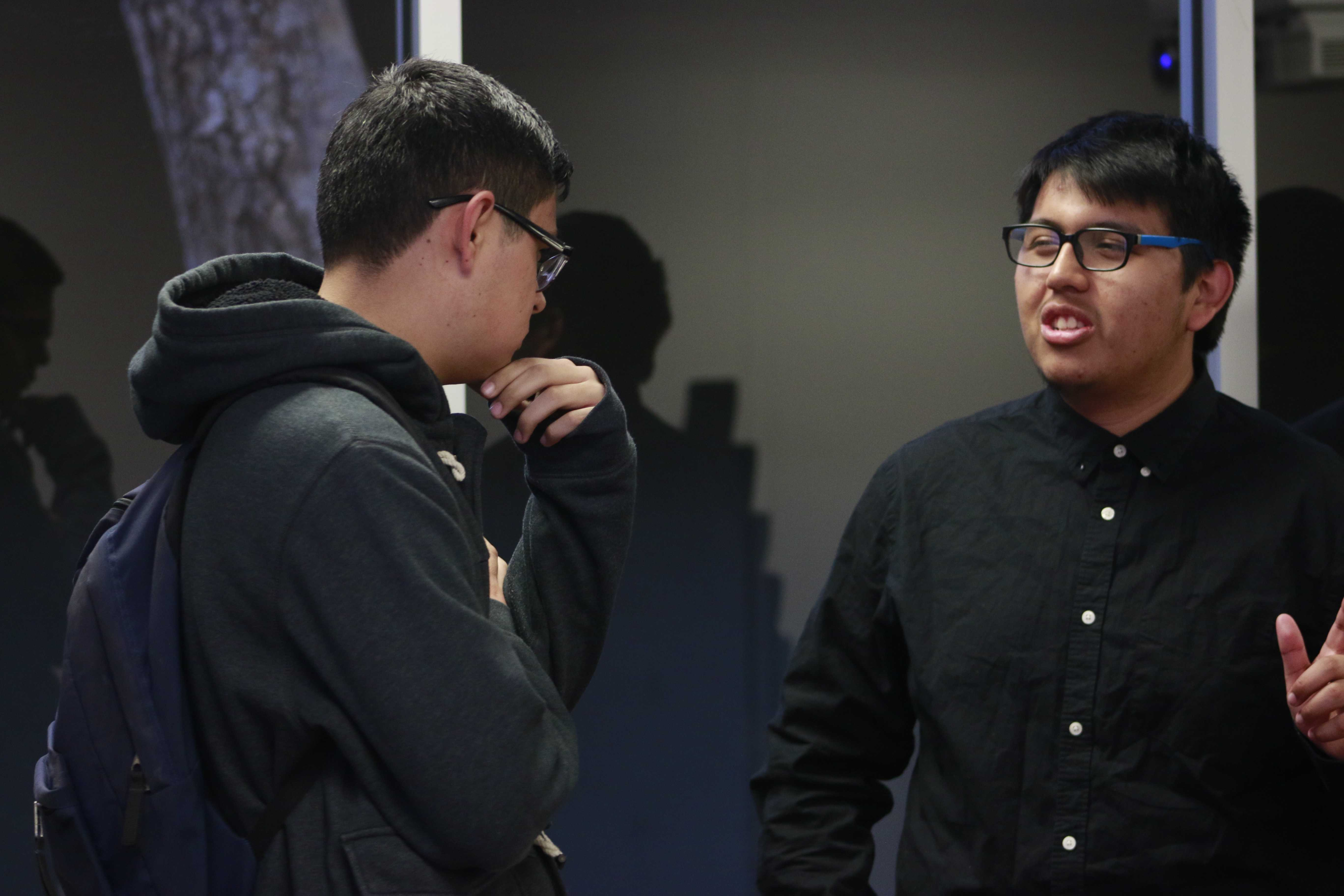 Miguel Guerrero, 18, an Electrical Engineering major (right) and Jeremy Perez (left), 20, an Computer Engineering major, conversing before an event held by the Society of Hispanic Professional Engineers.  Guerrero said afterwards that it was good to see