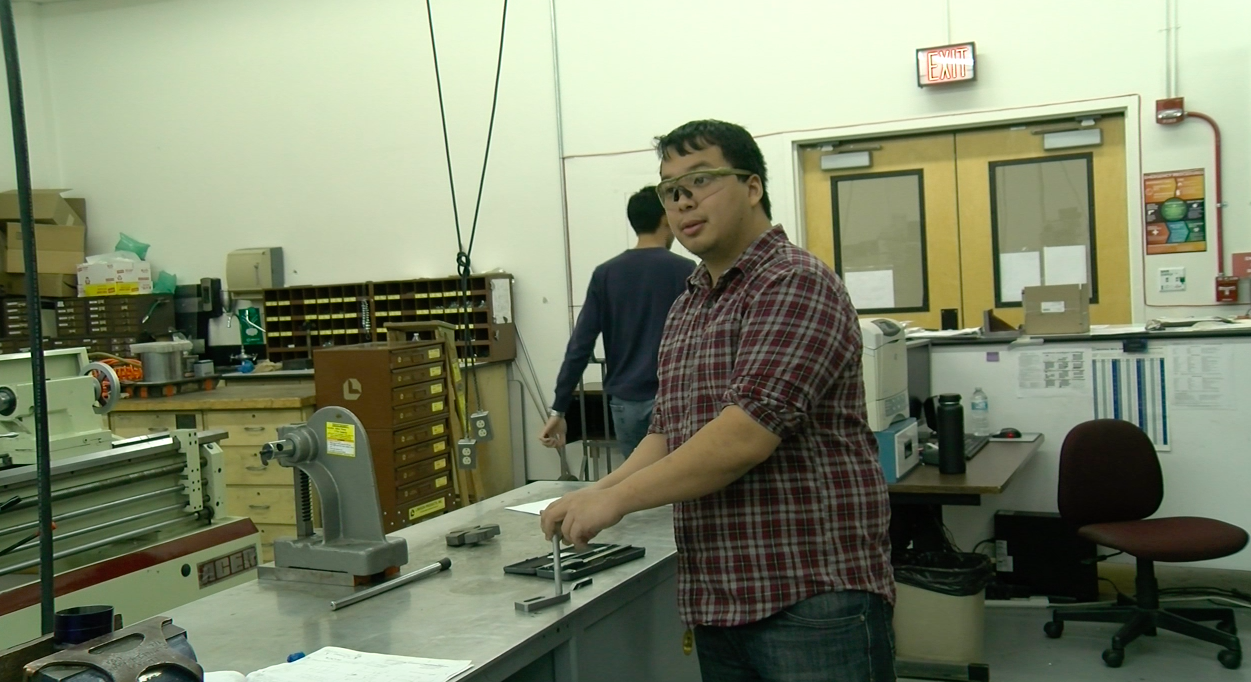 Mechanical engineering major Max Tchen in the Machine Shop wearing safety googles, everyone must wear while inside.