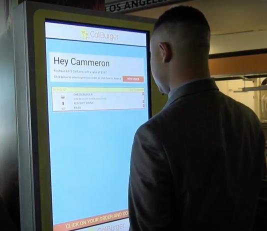 Man using large electronic display board