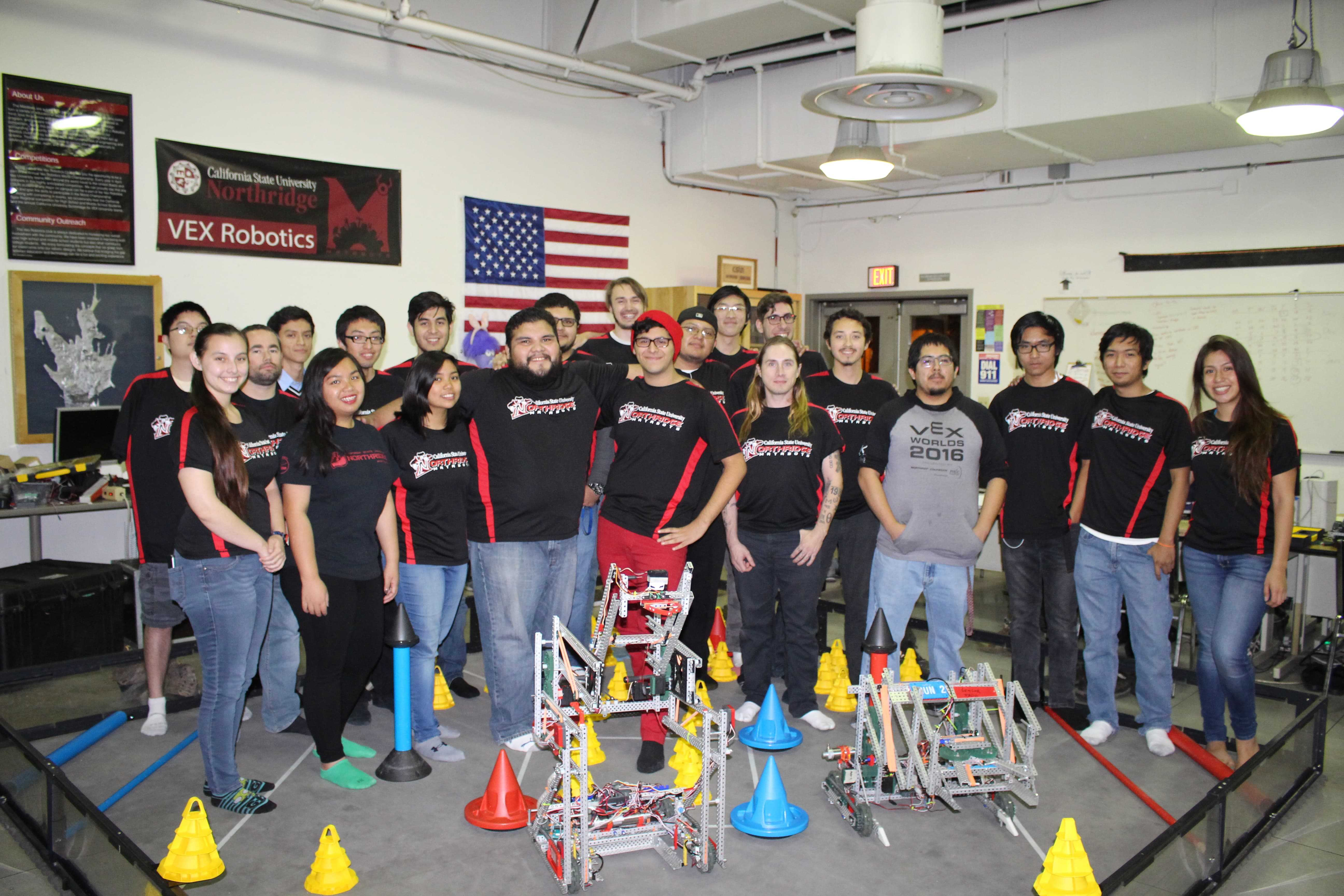The Vex Robotics team, or Matabots, stand in front of their two robots in team photo provided by Steven Paqueo.