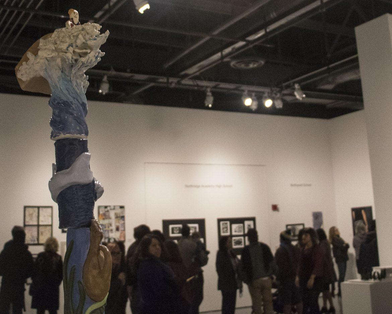 people walk through art gallery