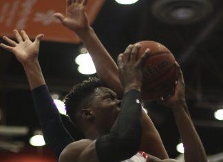 CSUN mens basketball player takes a shot