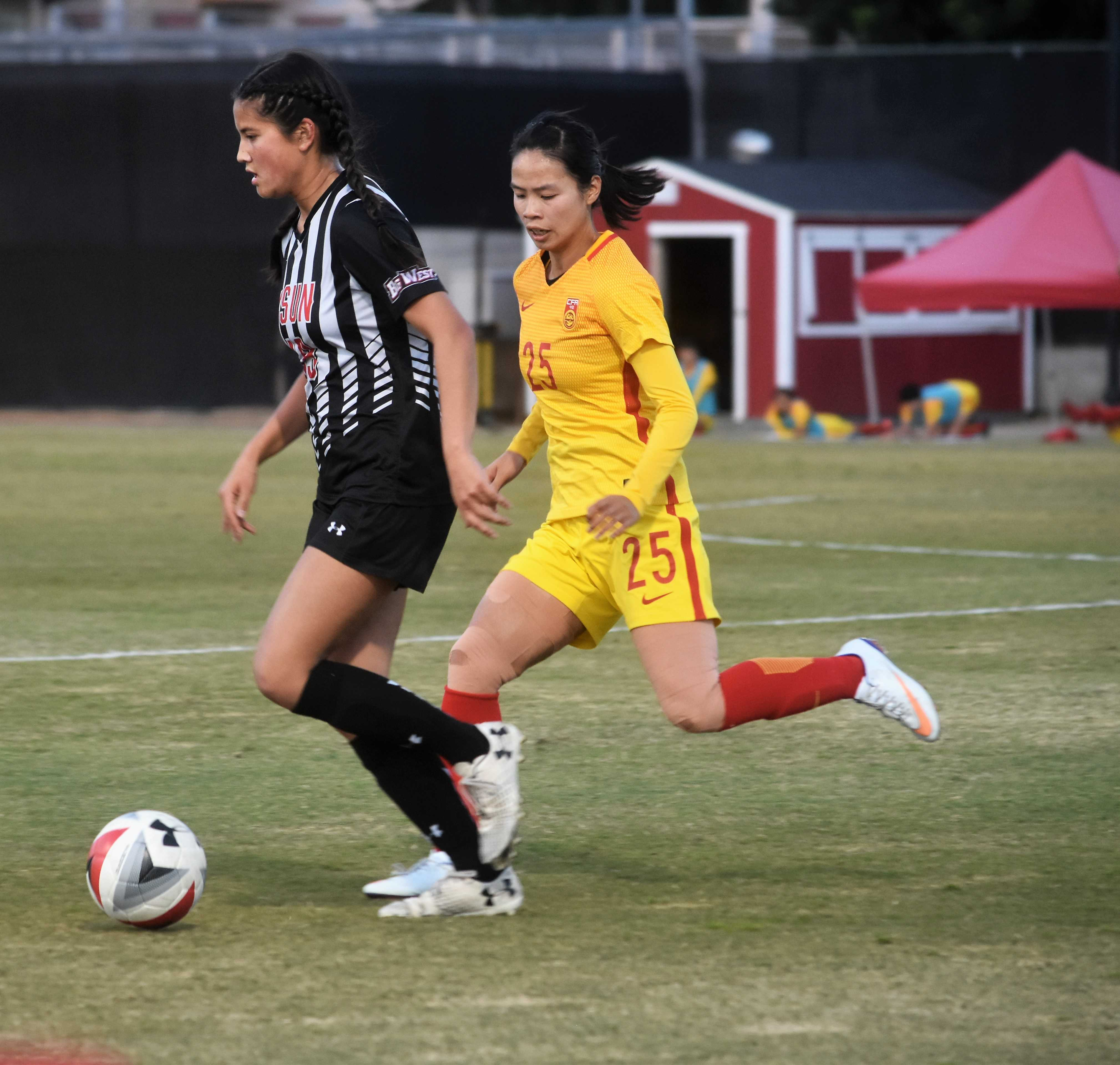 2017 Big West All-Freshman selection Amy Aquino is chased down by a Chinese midfielder. Aquino scored two goals and had one assist in 2017. Photo credit: Tamara Shapiro