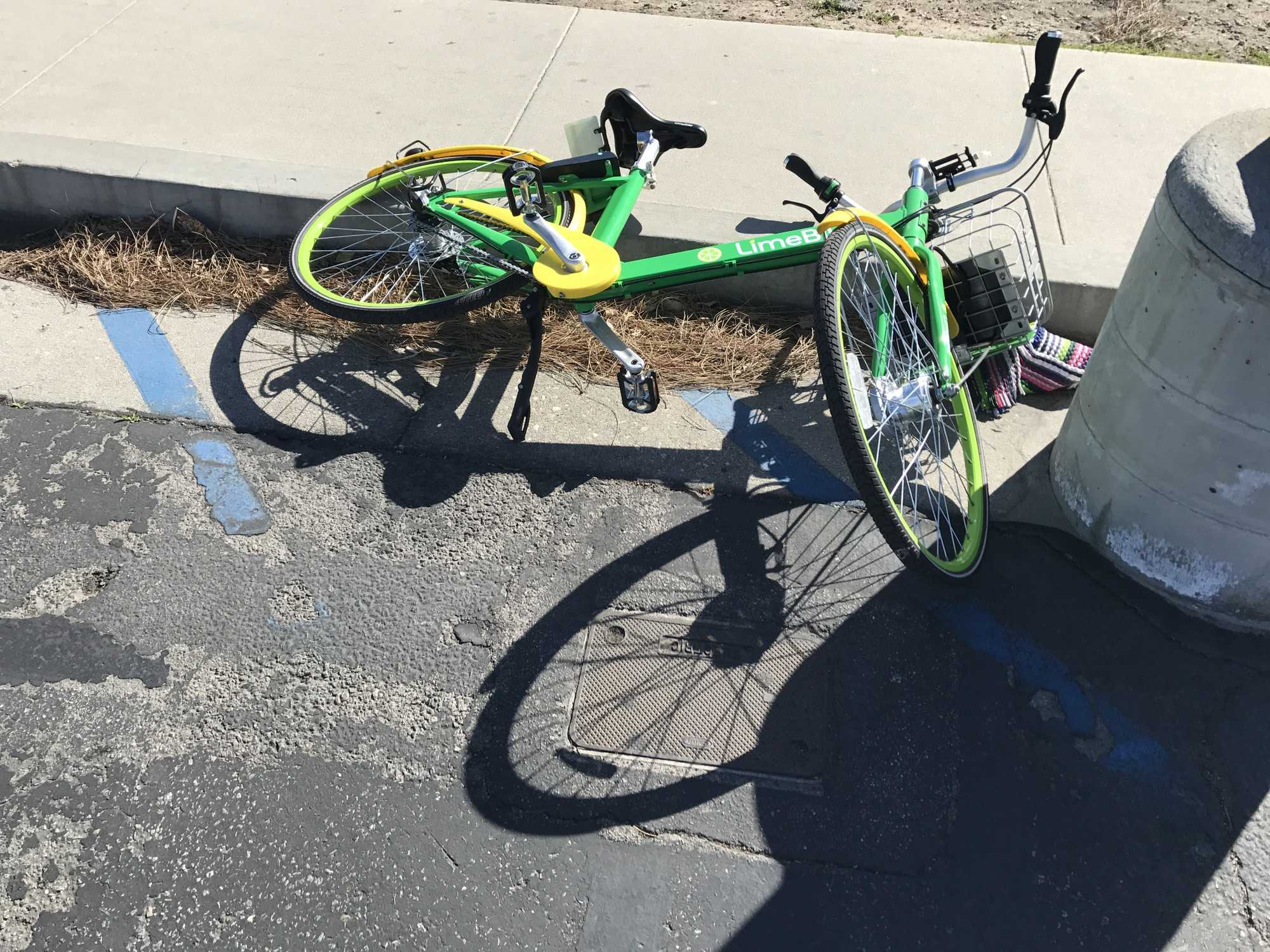 Abandoned LimeBikes can pose problems, as they cannot be moved unless they are paid for and activated Photo credit: Tandy Lau