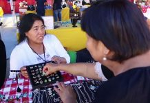 two women present their jewelry they have for sale