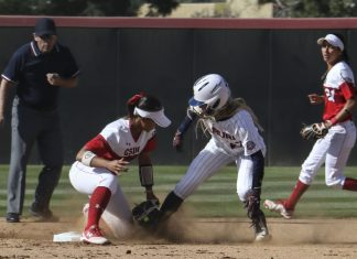 CSUN softball player tags out opponent as they collide on the base