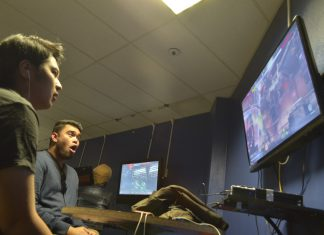 man shockingly watches video game screen
