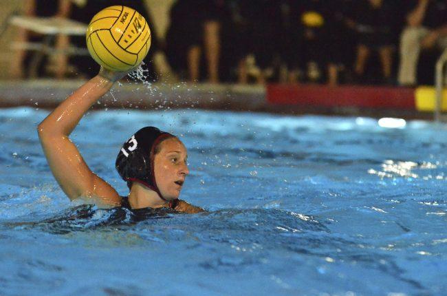 Woman throwing water polo ball