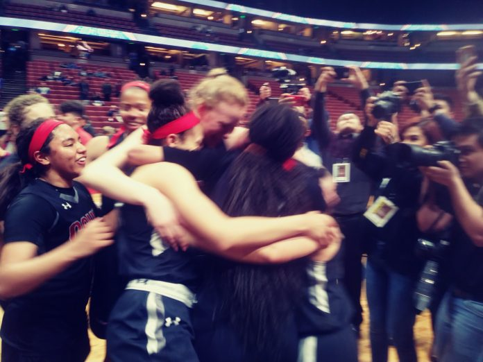 CSUN woman basketball hugging and celebrating on the court