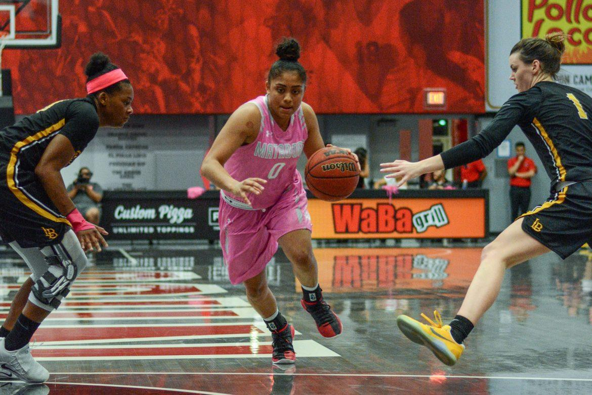 CSUN womans basketball dribbles ball across the court