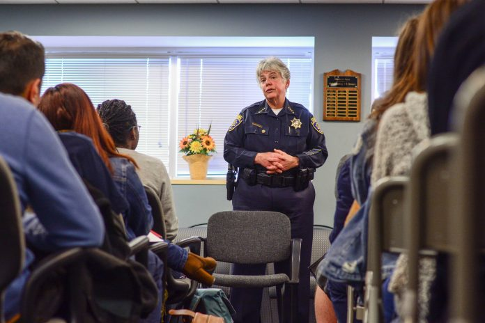 woman police officer speaking to a group of people
