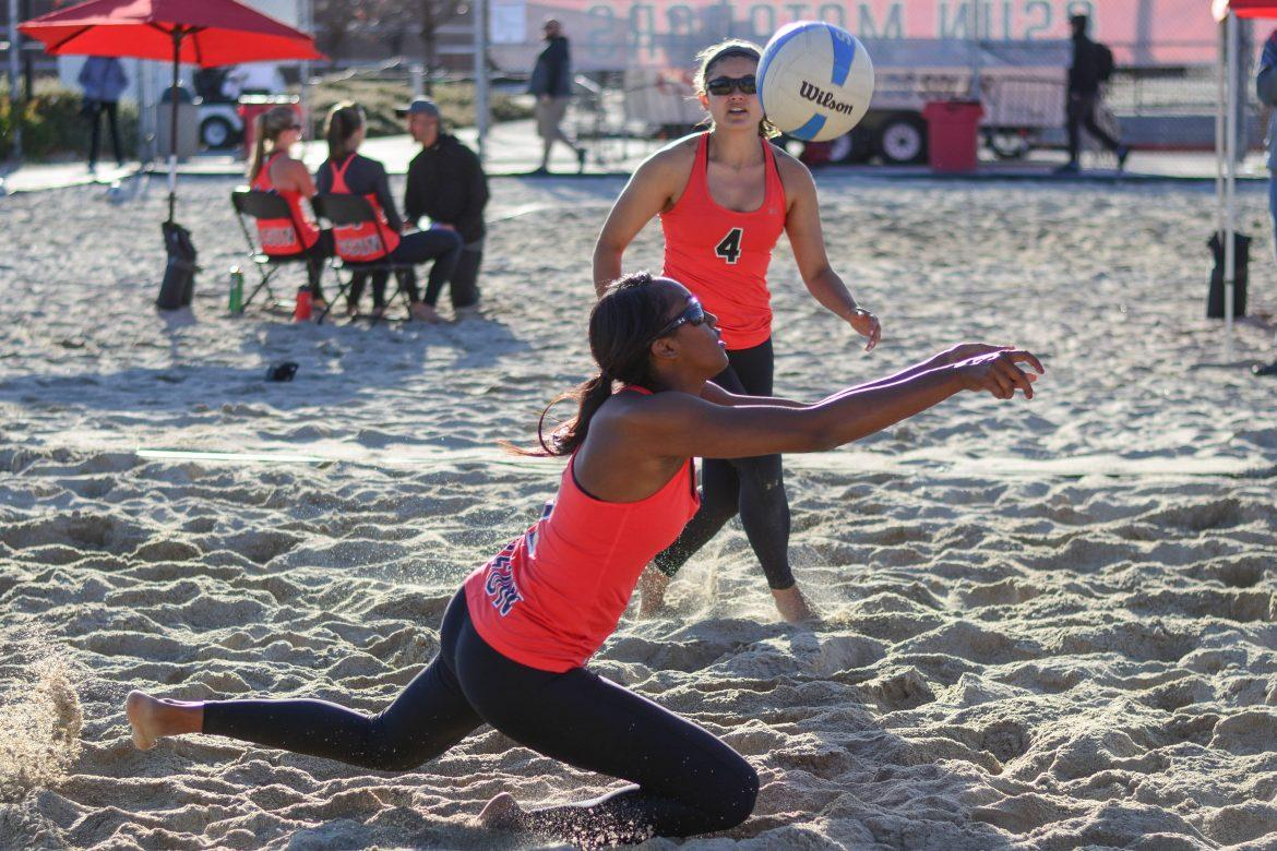 CSUN+womans+beach+volleyball+players+receive+the+ball+in+a+game