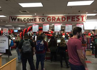 red and black banner inside bookstore reading Welcome to Gradfest